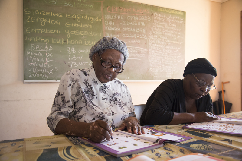 (L to R) Elizabeth Zondi, 77, and Caroline Cele, 60, with their literacy books at Muthande Society For the Aged, at the Richmond Centre, in Durban, April 25, 2016. PHOTO: EVA-LOTTA JANSSON